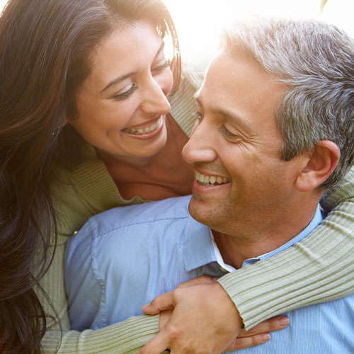 attractive-older-couple-hugging-and-smiling